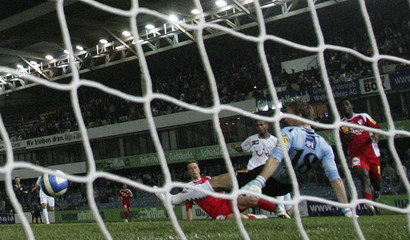 FC Zurich's Raffael scores against FC Sion during their Super League soccer match in Zurich