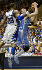 The University of North Carolina's Hansbrough drives past Duke University's Williams for two points during their NCAA basketball game in Durham