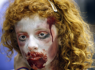 A young girl wearing make-up attends the 40th annual Comic Con Convention in San Diego