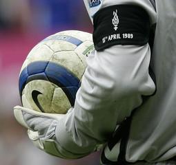 Aston Villa's Thomas Sorensen wears an arm band in memory of the Hillsborough disaster victims during their English Premier League match against Birmingham City in Birmingham