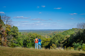 A couple admiring the scenery at Brown County State Park in fall
