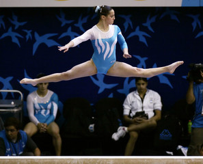 Deluzio of Argentina performs during beam portion of the women's team gymnastics competition at the Pan American Games in Rio De Janeiro
