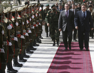Germany's Defence Minister Jung inspects the guard of honour with his Afghan counterpart Wardak in Kabul