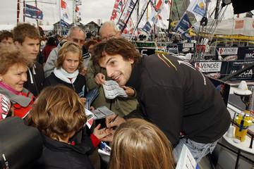 French skipper Jean-Baptiste Dejeanty signs autographs at Les Sables d'Olonne, on France's Atlantic coast