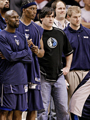 Dallas Mavericks' owner Mark Cuban watches game against Phoenix Suns with players in Phoenix.