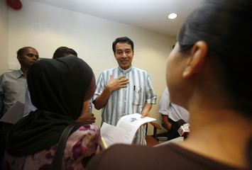 Husam speaks to journalists after a news conference in Kuala Lumpur