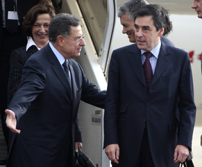 Lebanon's Prime Minister Fouad Siniora welcomes his France's counterpart Francois Fillon upon arrival at Beirut airport