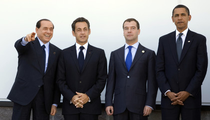 Italy's PM Berlusconi, France's President Sarkozy, Russia's President Medvedev and U.S. President Obama stand during a family photo at the G8 summit in L'Aquila