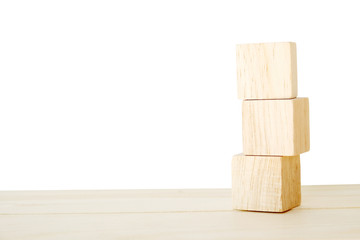 Three wooden cubes on wood table isolated on white background