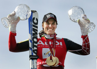 Dorfmeister of Austria shows her women's super-G and downhill World Cup trophys at the Alpine Skiing World Cup Finals in Are
