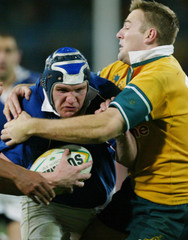 FRENCH MARCONNET RUNS THROUGH AN AUSTRALIAN TACKLE AT RUGBY UNION TESTIN STDNEY.