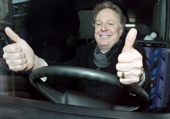 QUEBEC LIBERAL LEADER JEAN CHAREST SITS BEHIND THE WHEEL OF HISCAMPAIGN BUS.