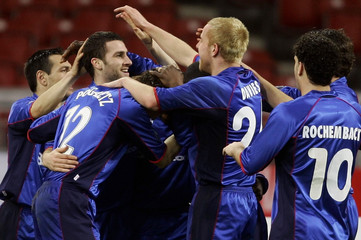 Middlesbrough's Parnaby celebrates his goal against Stuttgart with team mates during their UEFA Cup soccer match in Stuttgart