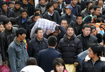 Crowd of passengers are pictured at the Beijing West Railway Station