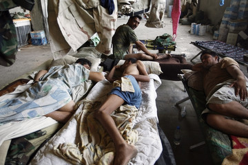 Soldiers of the Iraqi army sleep at an abandoned shopping mall serving as their base in Baghdad