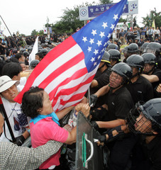South Korean riot policemen block conservative demonstrators during a protest at the Freedom ...