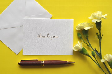 Thank you card pen and carnations on yellow