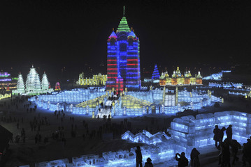 People visit ice sculptures for the upcoming 26th Harbin International Ice and Snow Festival at a park in Harbin