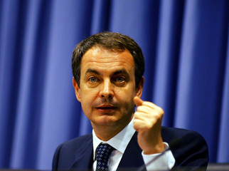 Spanish Prime Minister Zapatero delivers a speech during a conference about economy in Barcelona.