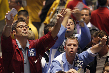 Traders in the Eurodollar pit signal orders at the CBOT in Chcago