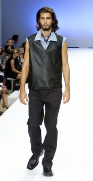 BLACK LEATHER VEST AND SLEEVELESS SHIRT AT KENNETH COLE SPRING SHOW.