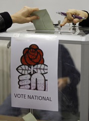 A socialist member casts her ballot at a polling station in Marseille