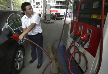A driver fills the tank of his car at a service station in Nanjing