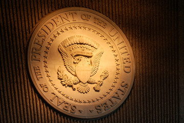 illuminated Presidential seal on wall