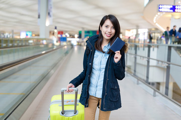 Woman holding passport for go travel