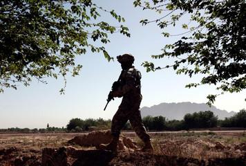 U.S. Army Sergeant First Class Baidoos patrols near the Masum Ghar military base in Zhari district