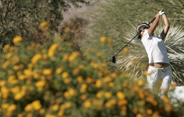 Ai Miyazato of Japan drives the ball from the fifth tee during the LPGA Samsung World Championship golf tournament at Bighorn golf club in Palm Desert