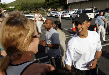 US President-elect Obama greets people after working out on Marine Corps Base Hawaii while on vacation over the holidays in Kailua
