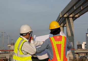 civil engineer man with  safety helmet standing in front of oil  building structure in heavy industry