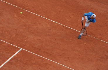 LLEYTON HEWITT OF AUSTRALIA SERVES TO GASTON GAUDIO OF ARGENTINA DURING THEIR QUARTER-FINAL OF THE ...
