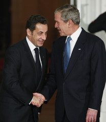 U.S. President George Bush greets France's President Sarkozy upon arrival at the North Portico of the White House in Washington