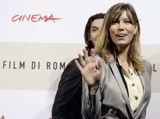 "Actress Biel is flanked by actor Barnes at the end of the photo call for their movie ""Easy Virtue"" at the Rome Film Festival"