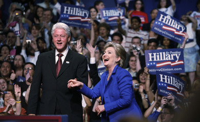 Hillary Clinton (D-NY) arrives onstage at her South Dakota and Montana presidential primary election night rally with her husband in New York
