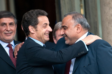 France's President Sarkozy congratulates Iraqi Vice President Adel Abdul Mahdi as he leaves the Elysee Palace in Paris