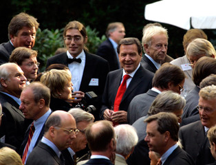 German Chancellor Gerhard Schroeder smiles during a visit at a steel company in Hamburg.