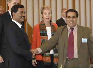 Tamilselvan LTTE political wing leader shakes hand with de Silva Sri Lanka's Government delegation leader at the opening of peace talks in Geneva