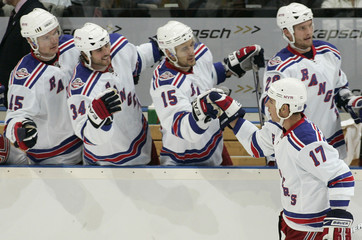 New York Rangers' Brandon Dubinsky is congratulated by his teammates after scoring against Tampa Bay Lightning during their NHL hockey game in Prague