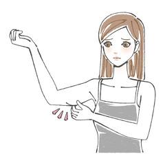 二の腕をつまむ女性 ロングヘア
