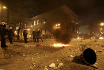 Policemen stand outside of the main Administrative building of Athens' University
