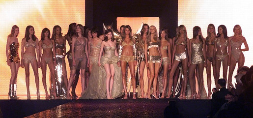 French model Laetitia Casta (C Left) is surrounded by models who presented lingerie sleepwear fashio..