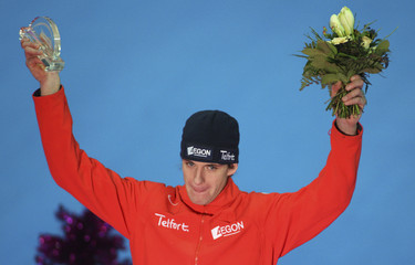 The Netherlands' Bos celebrates during the awards ceremony of the men's 1000 metres competition at the German speed skating championships in Erfurt