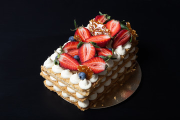 Puff homemade cake with cream and berries
