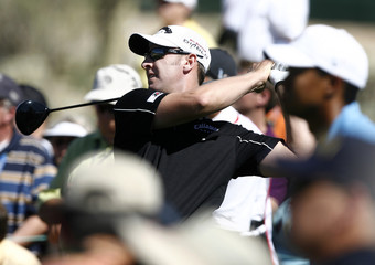 Brendan Jones tees off on the fifth hole during first round play against Tiger Woods at the WGC-Accenture Match Play Championship golf tournament in Marana