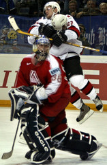 GLEN MURRAY OF CANADA LIFTS HIS TEAMMATE MATTHEW COOKE WHILE HE MARKED THE FIRST GOAL.