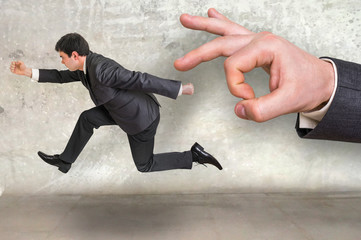 Small businessman running away from a boss pressure
