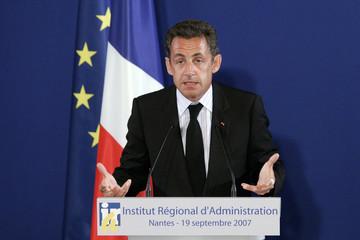 France's President Nicolas Sarkozy unveils his plan to reform civil service during a speech in Nantes